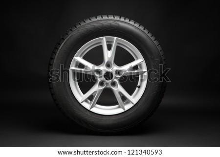 car tire with aluminum alloy wheel - stock photo