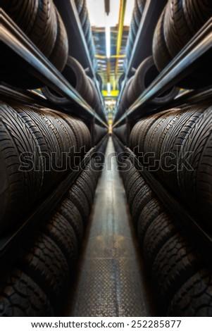Car tires at warehouse - stock photo