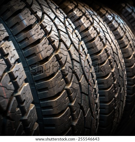 Car tires at warehouse - stock photo