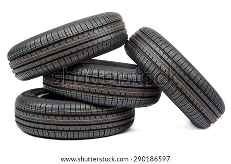 Car tires isolated on white background. - stock photo