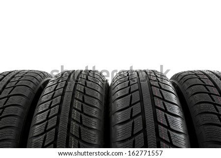 Car tires mature stack close-up Winter wheel profile structure on white background - stock photo