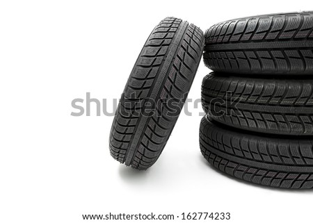 Car tires mature stack Winter wheel profile structure on white background - stock photo