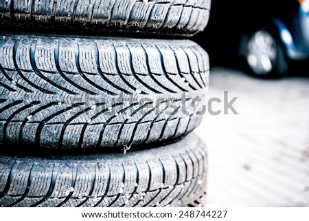 car tires prepared to replace in a garage - stock photo