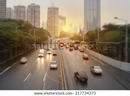 Car traffic against the sunset background - stock photo