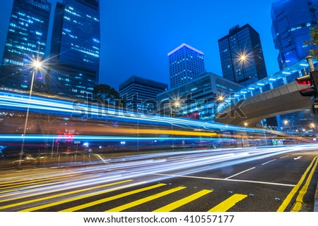 car trails on the high street,hongkong china. - stock photo