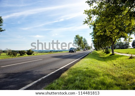 car traveling on a country road in Austria - stock photo