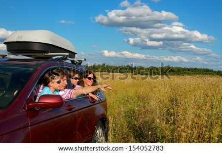 Car trip on family vacation, happy parents and kids travel and have fun, car insurance concept  - stock photo
