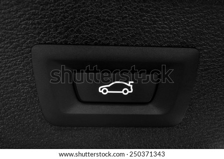 Car trunk closing button. Auto detail interior. - stock photo