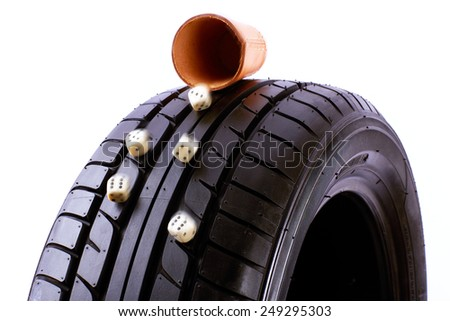 car tyre and dice  - stock photo