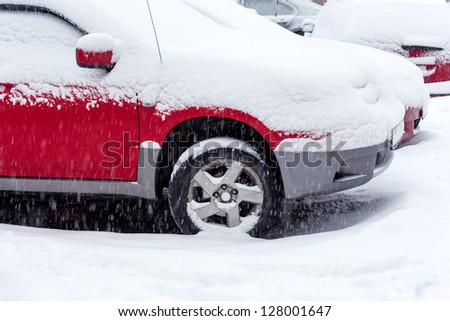 Car under snow in winter - stock photo