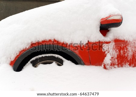 Car under snow in winter. - stock photo