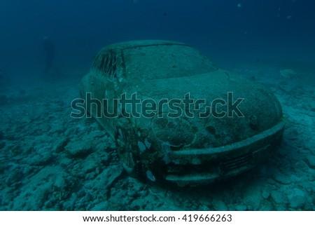 Car underwater - stock photo