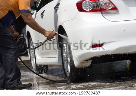 Car wash with flowing water  - stock photo