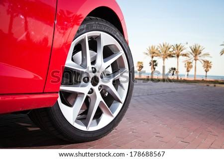 Car wheel in summer - stock photo