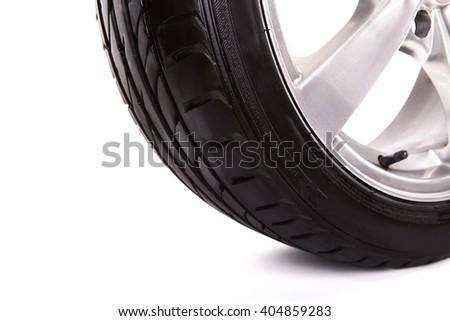 Car wheel on white background. - stock photo