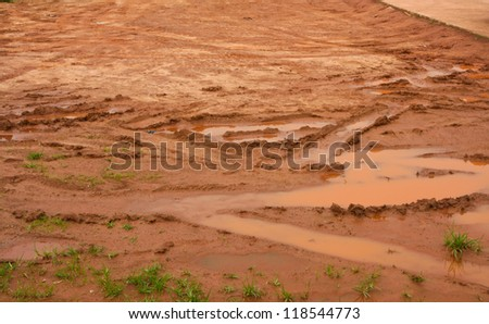 Car wheel track on dirty mud. - stock photo