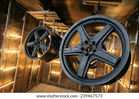 Car wheels on a baking at a high temperature thermal camera - stock photo