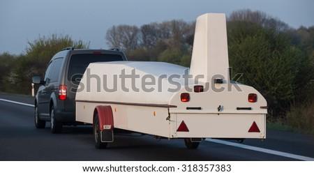 car with a sailplane trailer - stock photo