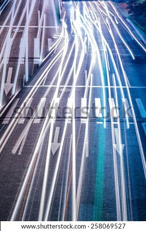 car with blur light through city at night - stock photo
