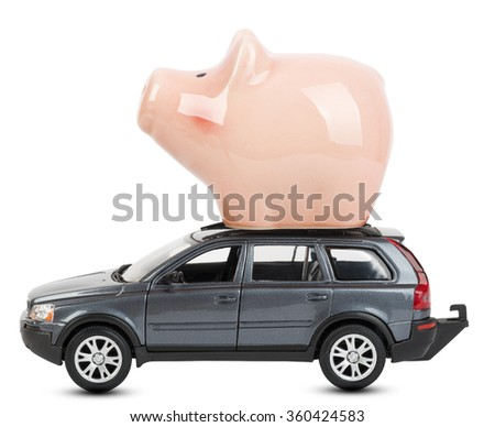 Car with piggy bank on white - stock photo