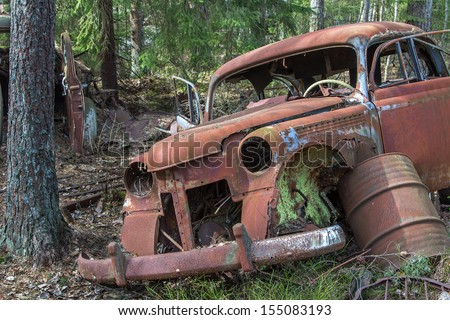 Car wreck in the woods - stock photo