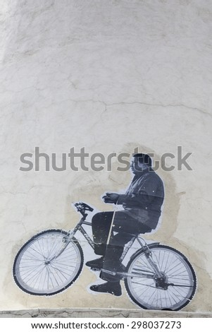 CARACAS, VENEZUELA, APRIL 20: Drawing of Hugo Chavez on a bike on a wall in Caracas downtown. Unknown artiste. Venezuela 2015. - stock photo