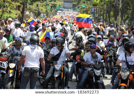 CARACAS, VENEZUELA - MARCH 22, 2014: Venezuelans protest in the street against the government for human rights violations and killings of civilians in peaceful demonstrations - stock photo
