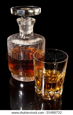 Carafe and a glas whiskey - stock photo