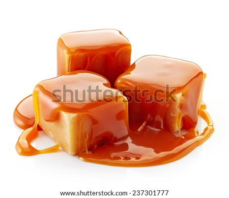 caramel candies and caramel sauce isolated on a white background - stock photo