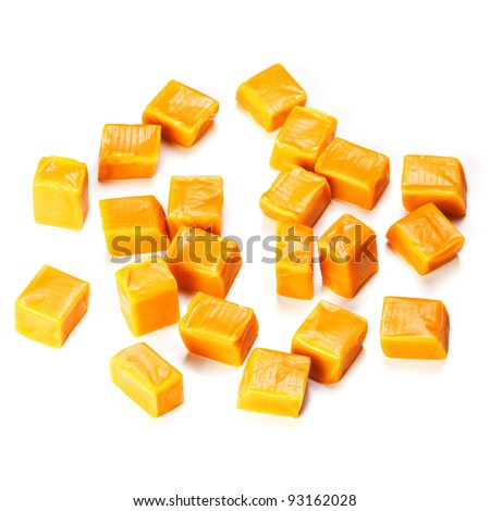 Caramel candy cube isolated on a white background - stock photo