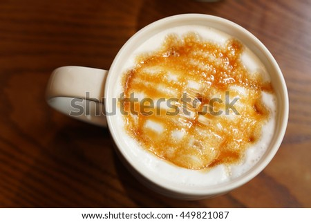 caramel latte coffee with whipped cream - stock photo