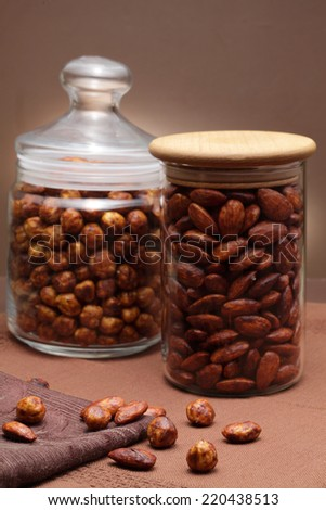 Caramelized almond nuts and hazel nuts  with with cinnamon and sugar - stock photo