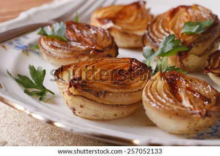 caramelized onions and parsley on a white plate close-up. horizontal - stock photo