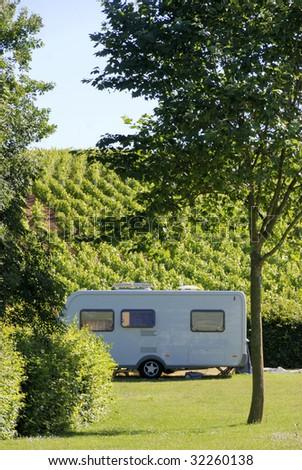 Caravan at camping in France, located between vineyards - stock photo