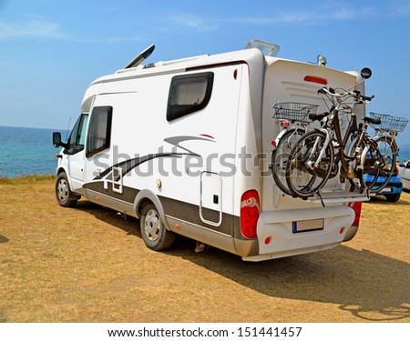 caravan holidays car bicycle  - stock photo