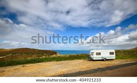Caravan trailer at the cliffs of Anse de Camaret Celtic sea bay in France - stock photo