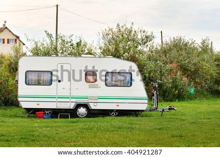 Caravan trailer on a green lawn at the camping in France - stock photo