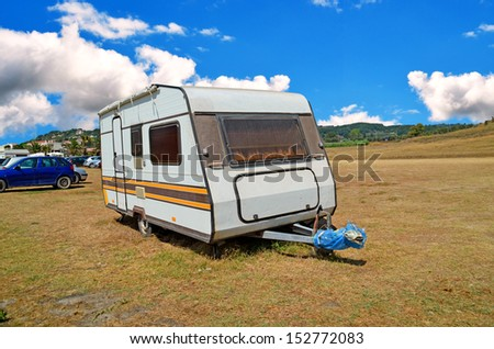 caravan trailer sky clouds - stock photo