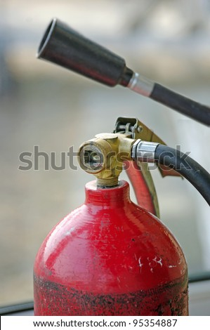 carbon dioxide fire extinguisher, and a funnel with a tube for gas - stock photo