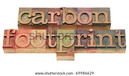carbon footprint - word sin vintage wooden letterpress printing blocks, stained by color inks, isolated on white - stock photo