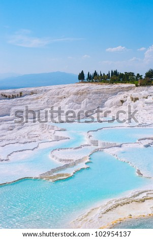 Carbonate travertines with blue water - unique nature wonder in Pamukkale, Turkey - stock photo