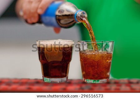 Carbonated drink poured into a glass. - stock photo