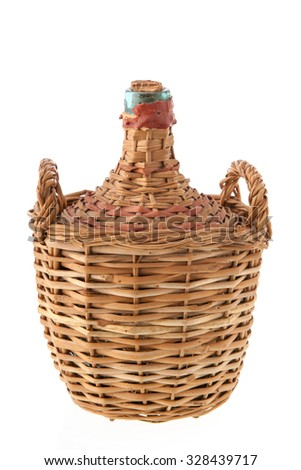 Carboy bottle with glass in wicker isolated over white background - stock photo