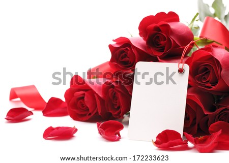 Card and roses on white background - stock photo
