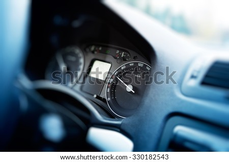Card dashboard in motion with odometer showing 60 kmh - regular speed - stock photo