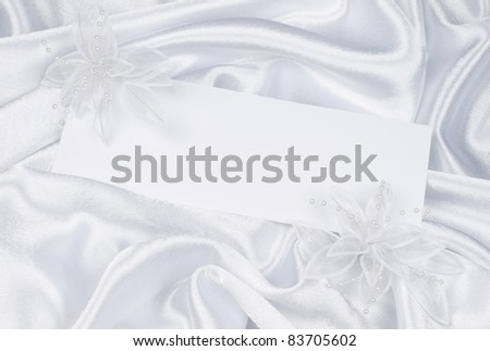 card for text and weddings accessories on white silk - stock photo