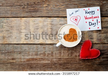 card for Valentines day, red toy heart and a cup of coffee on a dark wood background. toning. selective Focus - stock photo