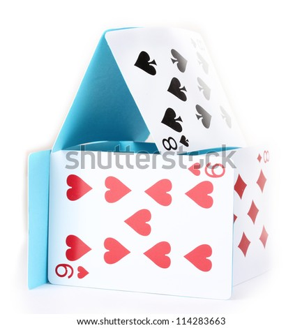 Card house isolated on white - stock photo