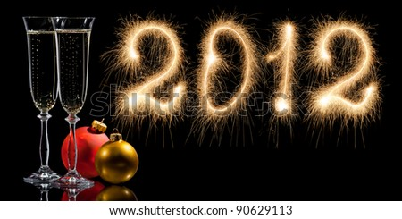 Card. New Year 2012 made of real sparkles and two glasses of champagne - stock photo