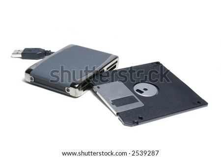 Card reader for cf, ms, ms duo pro, sd, sm, mmc, etc. with 1,5 floppy isolated on white - stock photo